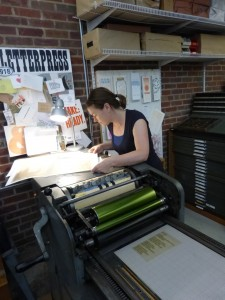 Laura Kinneberg looking over a print.